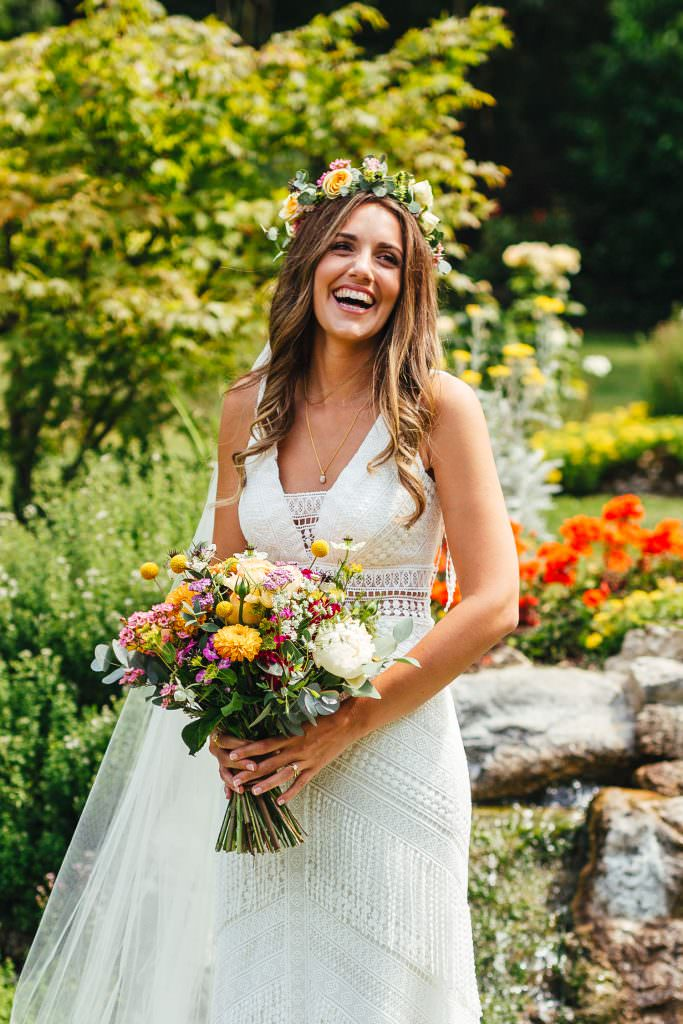 Bohemian Bridal portrait during during Brook Farm Festival Wedding Photography in Hertfordshire. Design by watters bohemian wedding dress