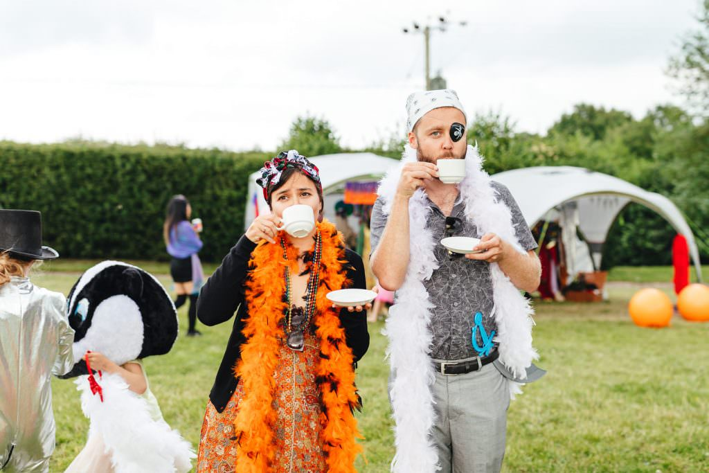 Pirate hour during Smoke bombs in fields during Festival Frickley Lake Wedding | Sussex Wedding Photography
