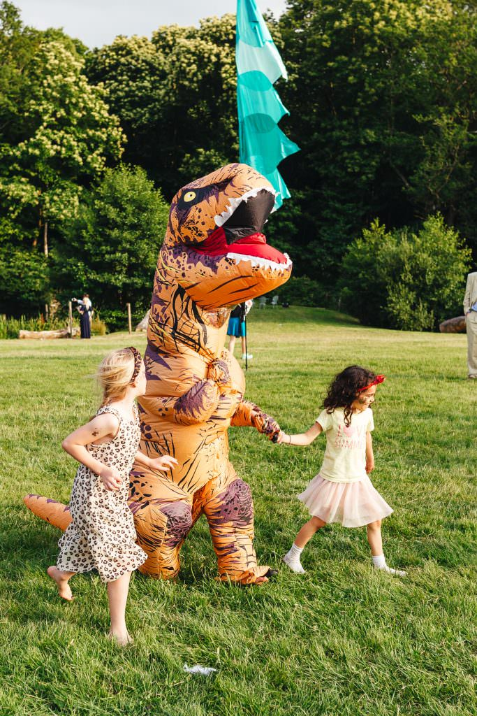 Blow up dinosaur fancy dress at wedding during Festival Frickley Lake Wedding | Sussex Wedding Photography