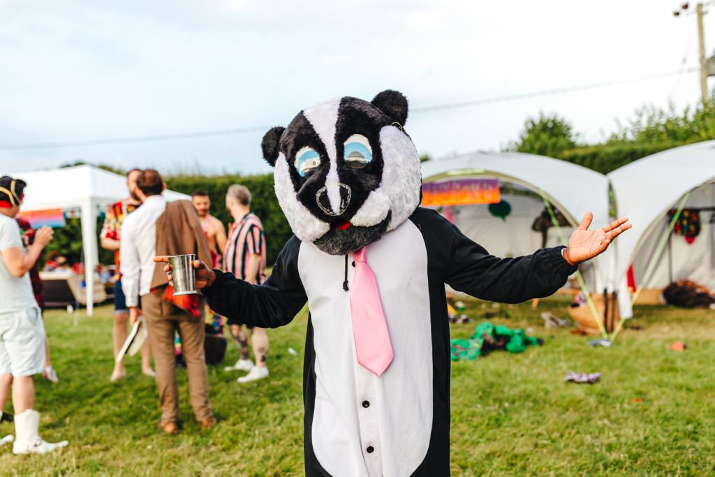 Fancy dress at fun wedding during Smoke bombs in fields during Festival Frickley Lake Wedding | Sussex Wedding Photography