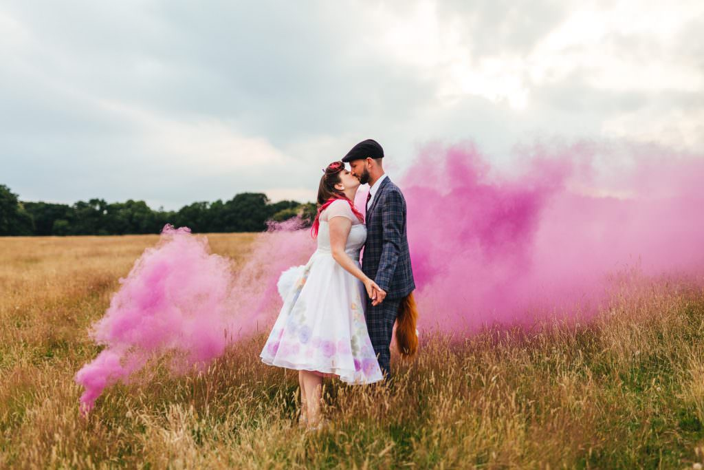 Smoke bombs in fields during Festival Frickley Lake Wedding | Sussex Wedding Photography