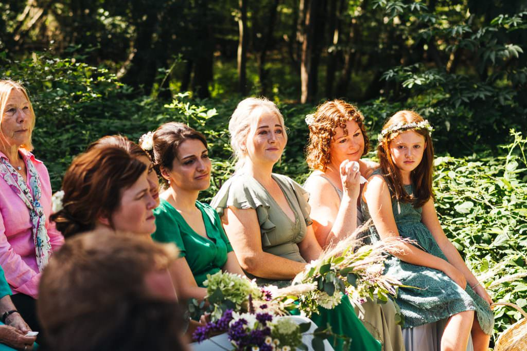Bridesmaids getting emotional at woodland ceremony at Hawthbush Farm Wedding Photography