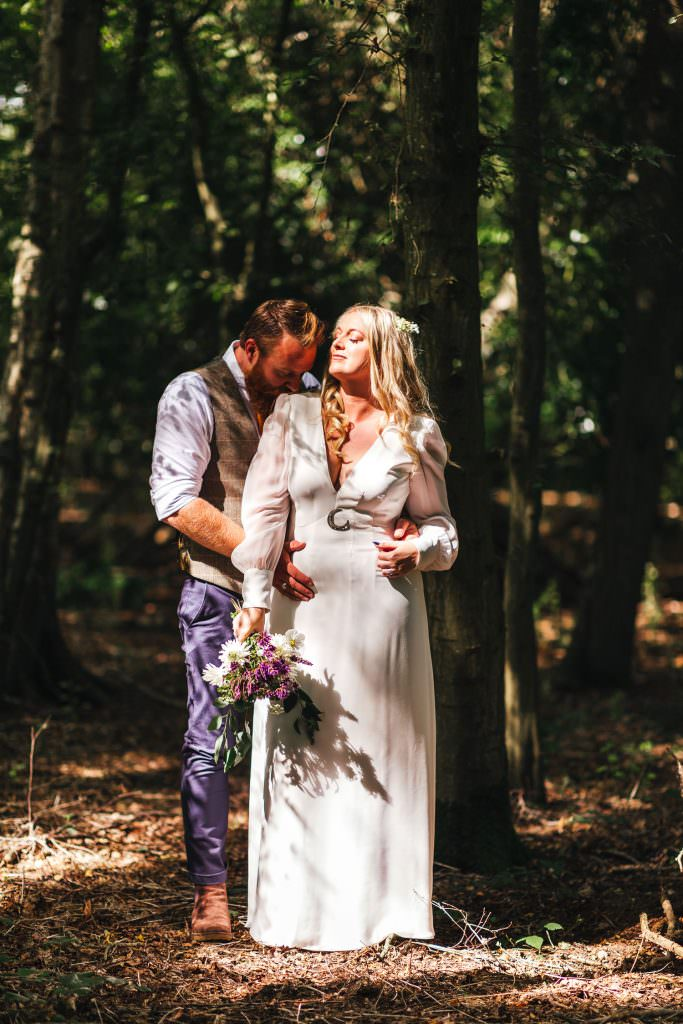 Bride and groom in sunlight in the woods during Hawthbush Farm Wedding Photography