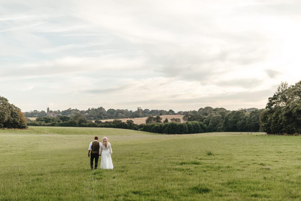 Rolling hills and bride and groom Hawthbush Farm Wedding Photography