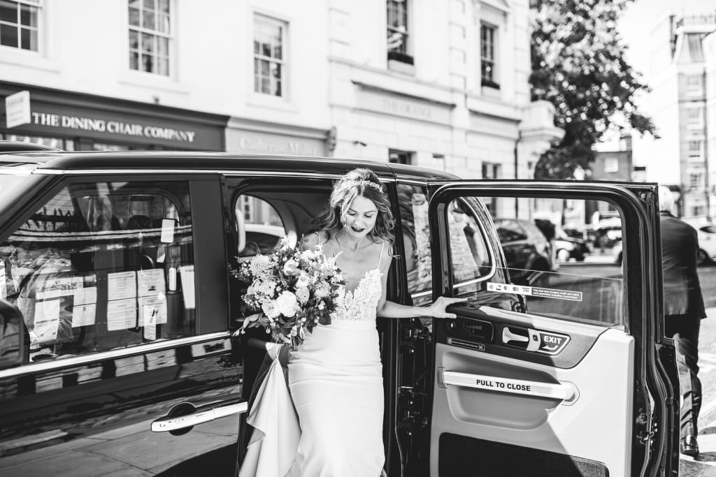 Bride gets out of black cab ready to get married! A London Wedding at Battersea Power Station