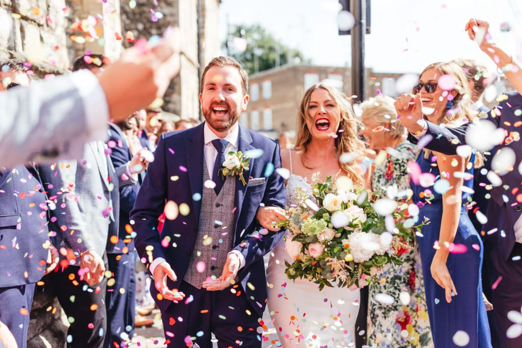 natural and fun confetti exit at London Wedding at Battersea Power Station