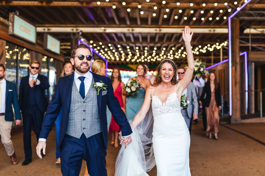 Bride and groom enter onto No.29 power station west during London Wedding at Battersea Power Station