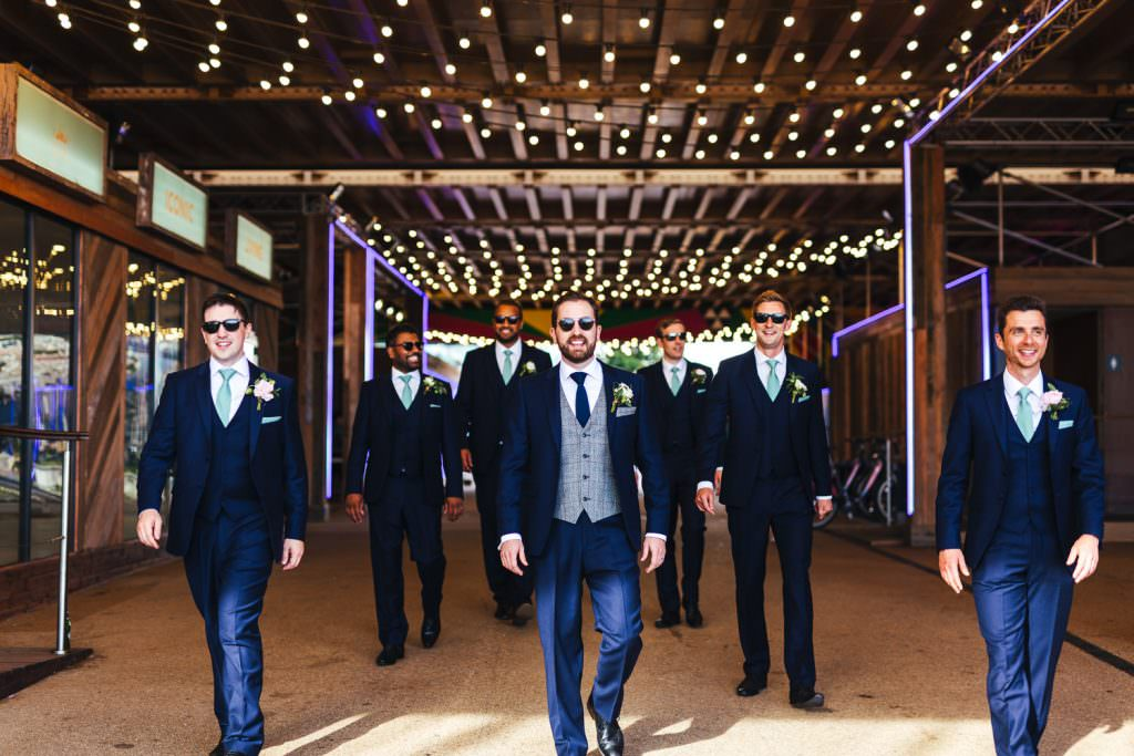 Groom and groomsmen No.29 power station west during London Wedding at Battersea Power Station
