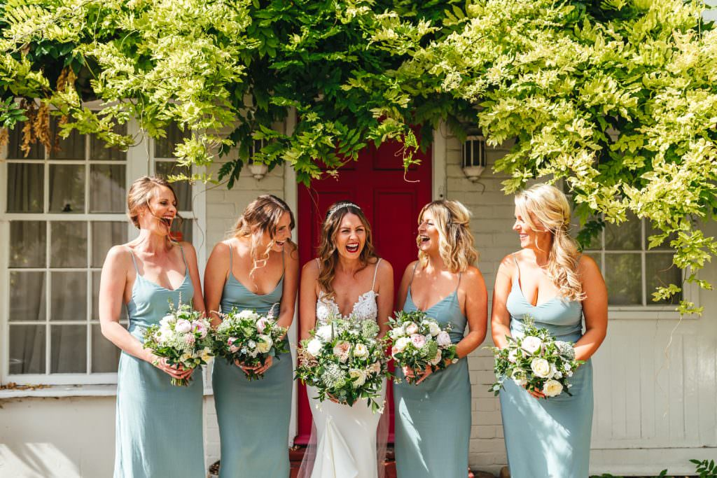 Bride and bridesmaids laughing during London Wedding at Battersea Power Station