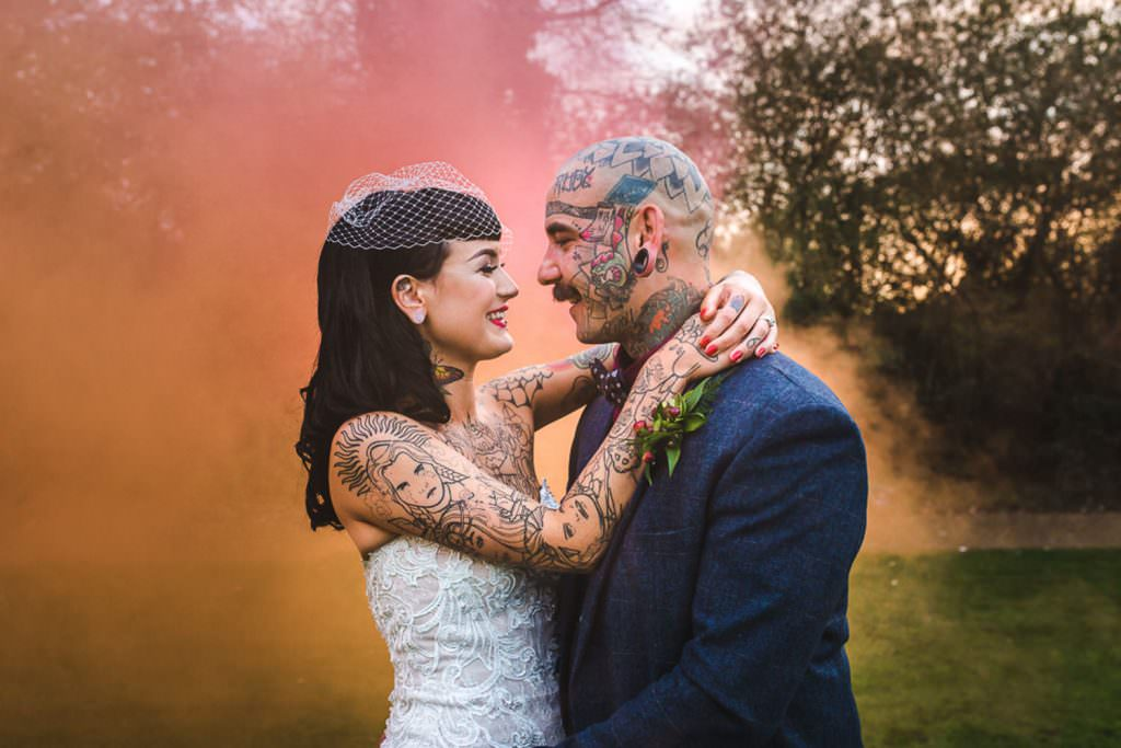 Smoke Bomb Wedding Photography with tattooed couple