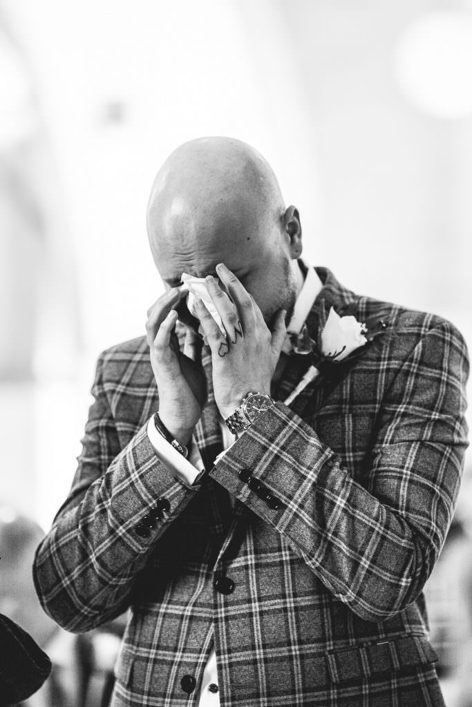 emotional groom at Tithe Barn Petersfield Wedding, crying as the bride walks in