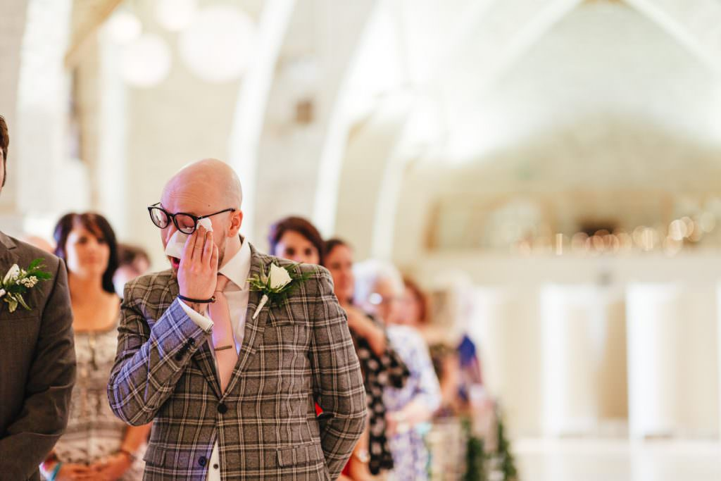 emotional groom at Tithe Barn Petersfield Wedding