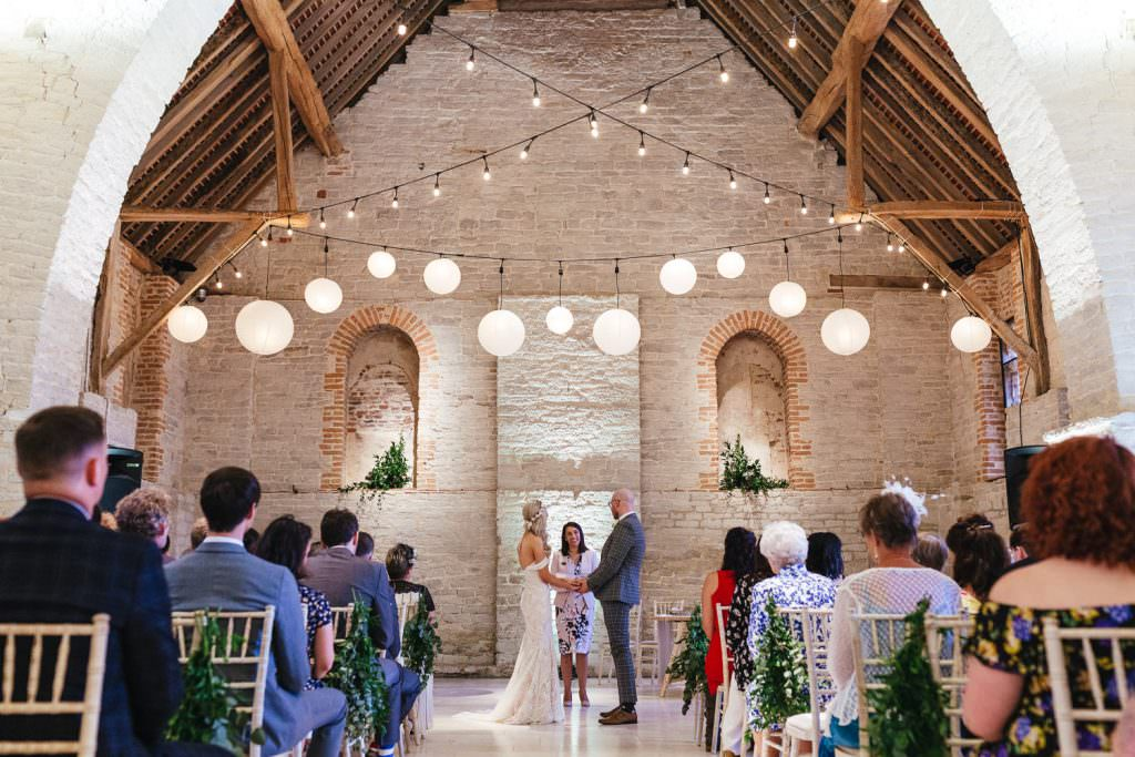 Bride and groom during ceremony at  Tithe Barn Petersfield Wedding