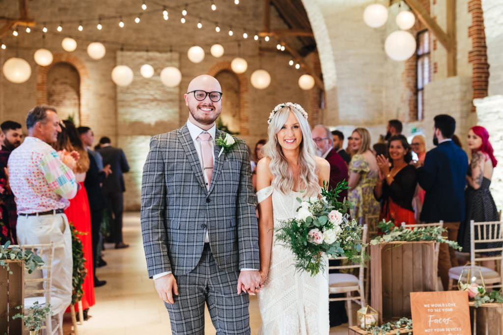 Happy faces as bride and groom just got married at Tithe Barn Petersfield Wedding