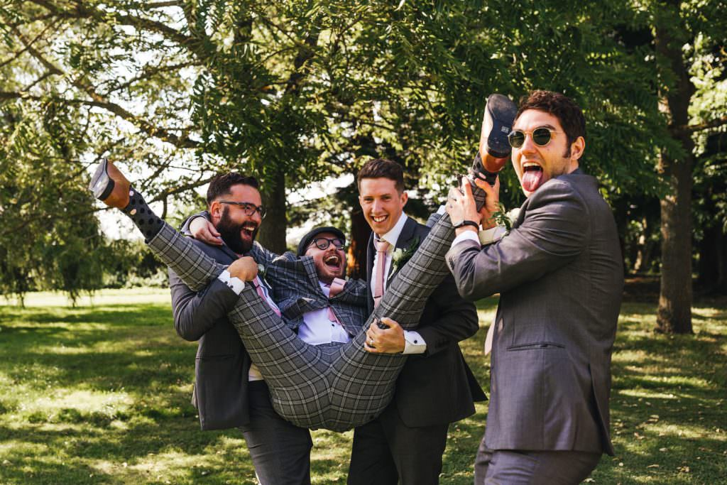 fun silly groom and groomsmen shot at Tithe Barn Petersfield Wedding.