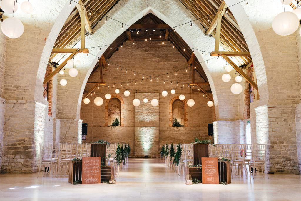 The barn at Tithe Barn Petersfield Wedding with ceremony set up and lights