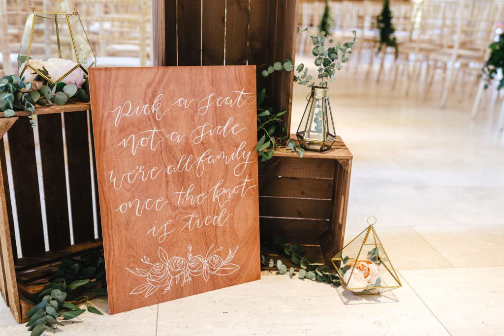 pick a seat not a side DIY wooden sign at Tithe Barn Petersfield Wedding