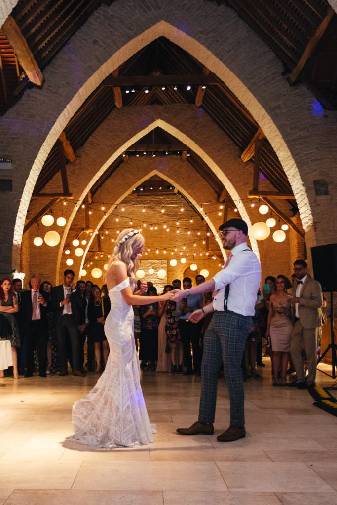 First dance at at Tithe Barn Petersfield Wedding. Bride in Watters Boho Bohemian Dress