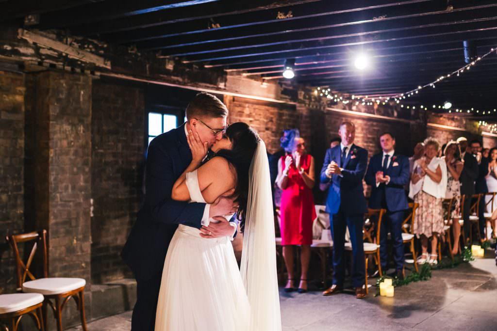 first kiss at Trinity Buoy Wharf Urban Neon Wedding