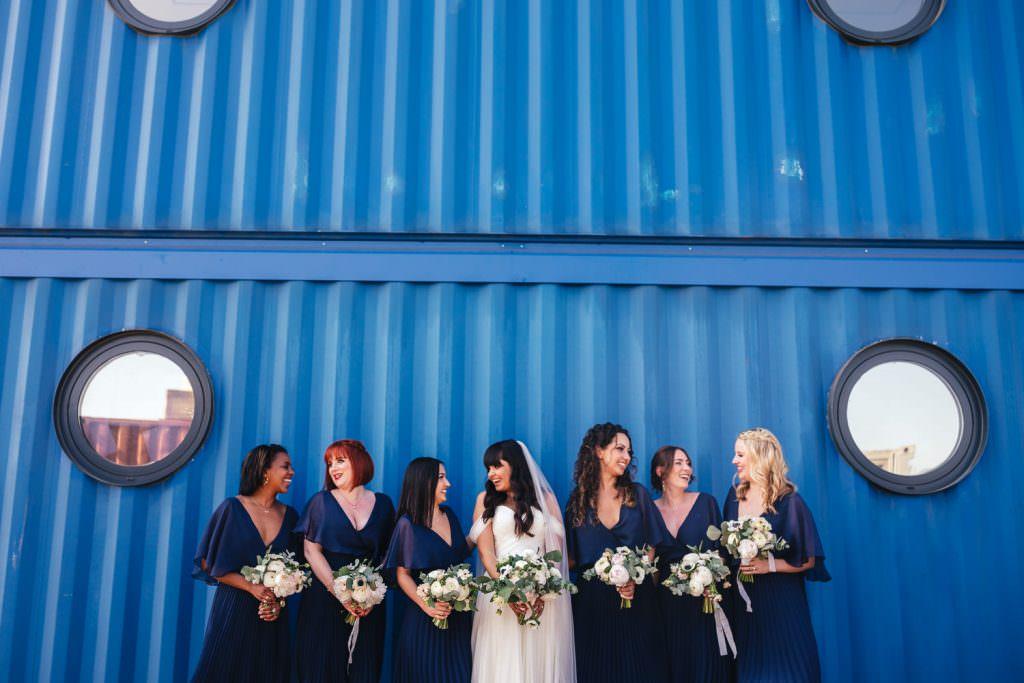 Bride and bridesmaids at Industrial, modern wedding at Trinity Buoy Wharf Urban Neon Wedding