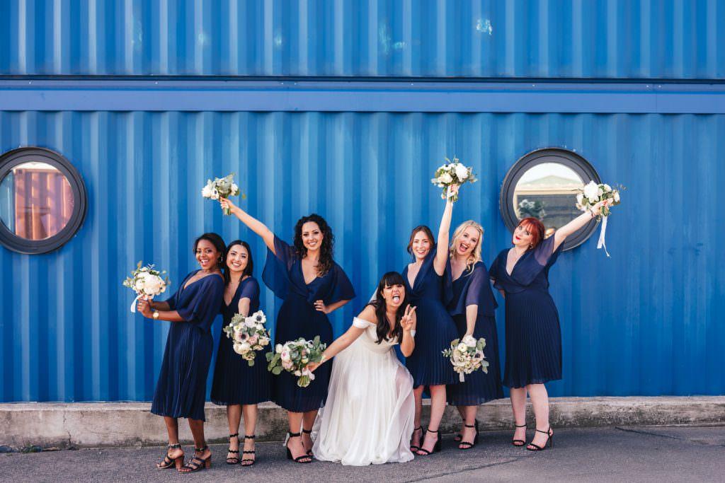 Bride and bridesmaids at Industrial, modern wedding at Trinity Buoy Wharf Urban Neon Wedding. Alternative wedding photography in London