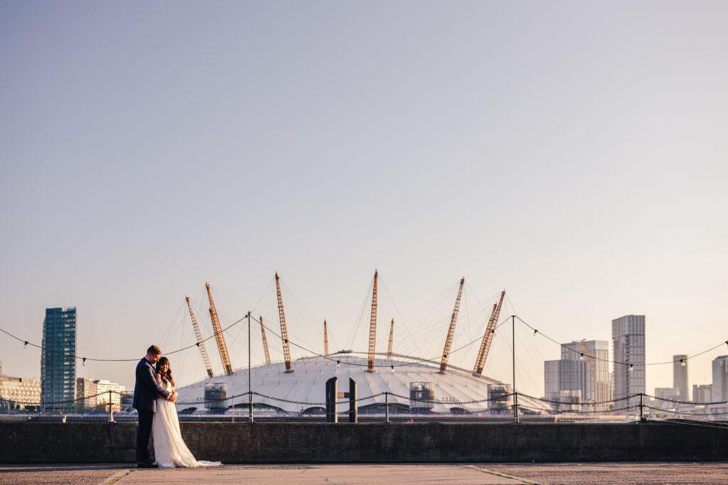 Golden hour couple portraits at Industrial, modern wedding at Trinity Buoy Wharf. Urban Neon Wedding. Alternative wedding photography in London