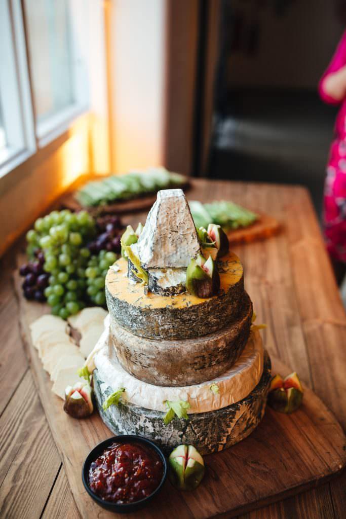 Cheese tower at Industrial, modern wedding at Trinity Buoy Wharf. Urban Neon Wedding. Alternative wedding photography in London