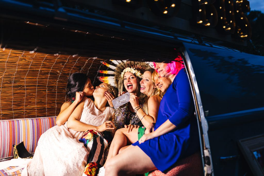 Fun in a VW camper photobooth during Summer Festival Wedding Hampshire Photography