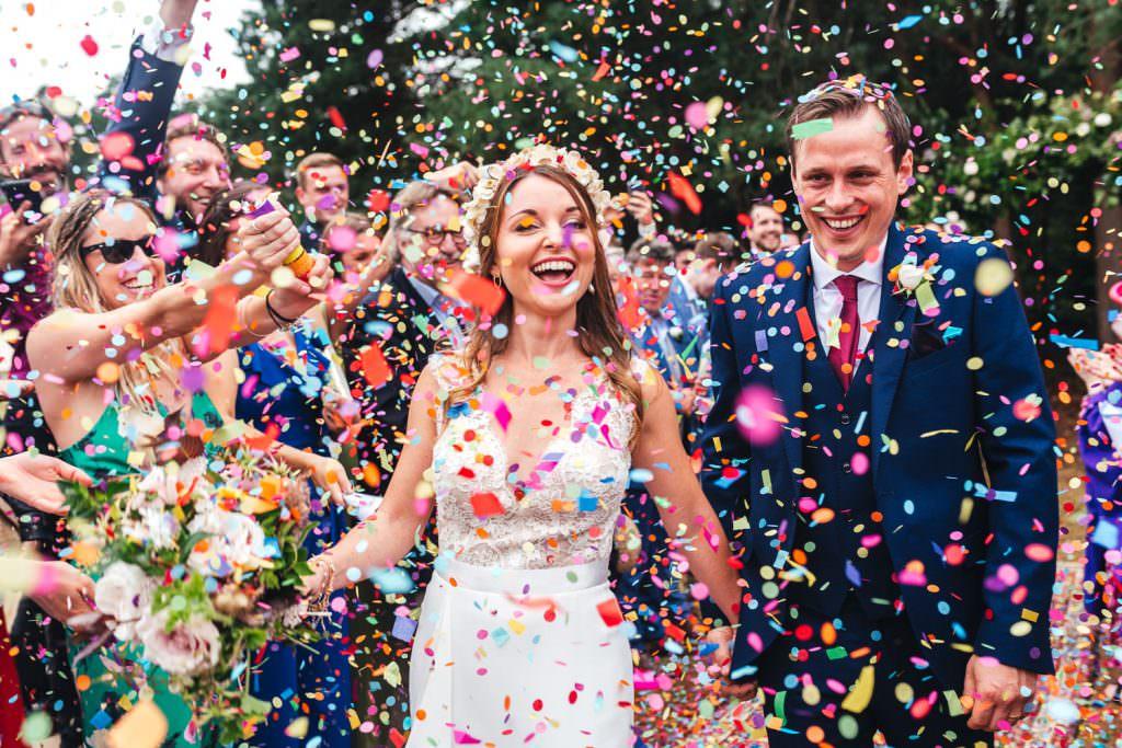 Rainbow biodegradable confetti during Summer Festival Wedding Hampshire Photography
