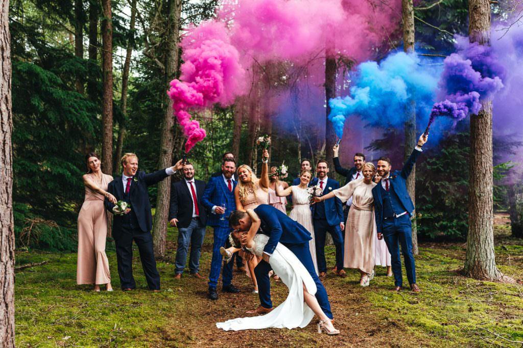 Smoke bomb wedding photography during Summer Festival Wedding Hampshire Photography Uk