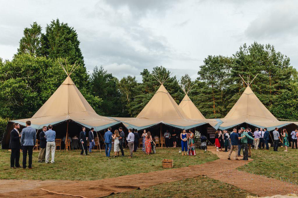 Beautiful world tents tipis at Summer Festival Wedding Hampshire Photography