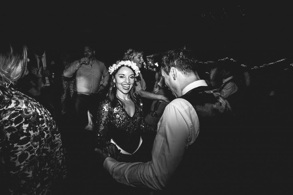 fun on the wedding dance floor at Summer Festival Wedding Hampshire Photography. Bride wears soul clothing glitter outfit