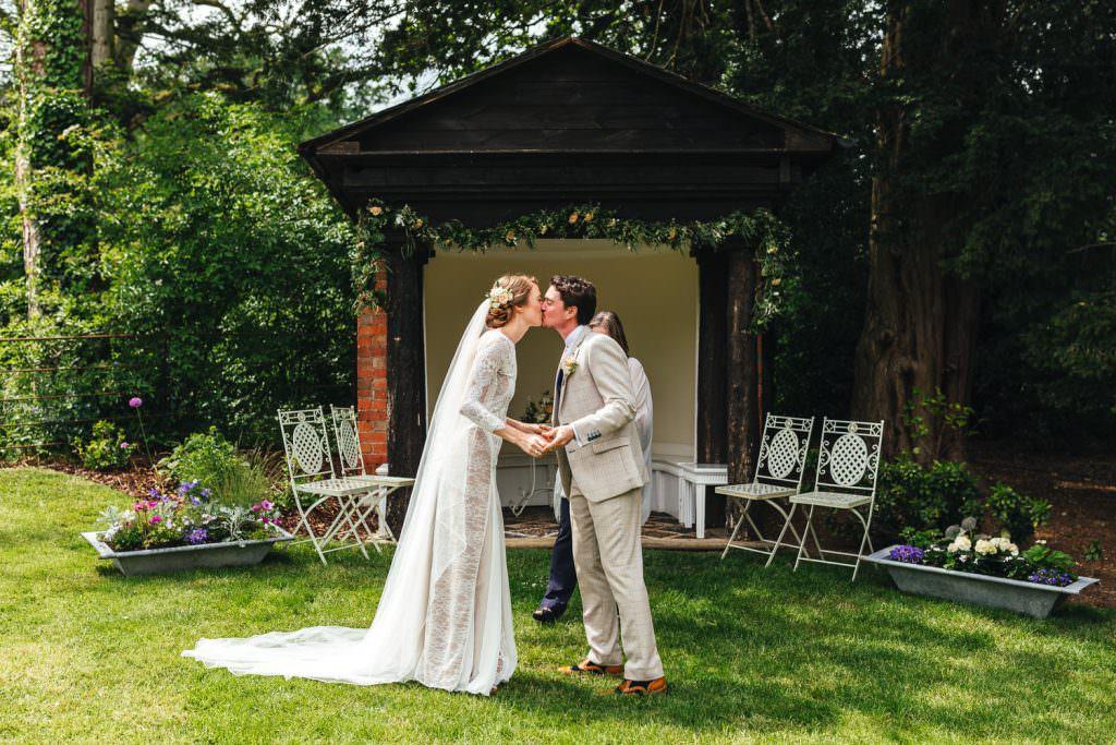 First kiss at The Secret Walled Garden Wasing wedding