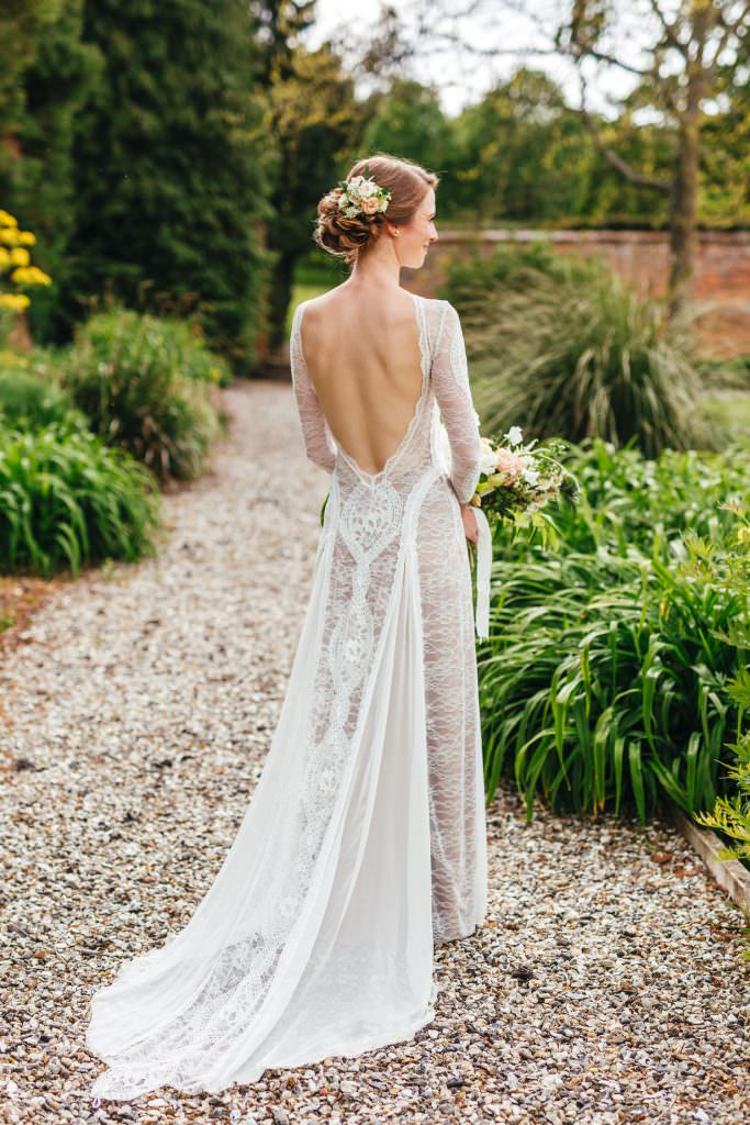 Bridal portrait of Inca dress. at The Secret Walled Garden Wasing wedding. Bride wears grace loves lace