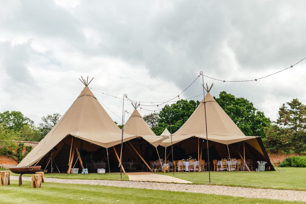 awesome tipi festival wedding at The Secret Walled Garden Wasing wedding.