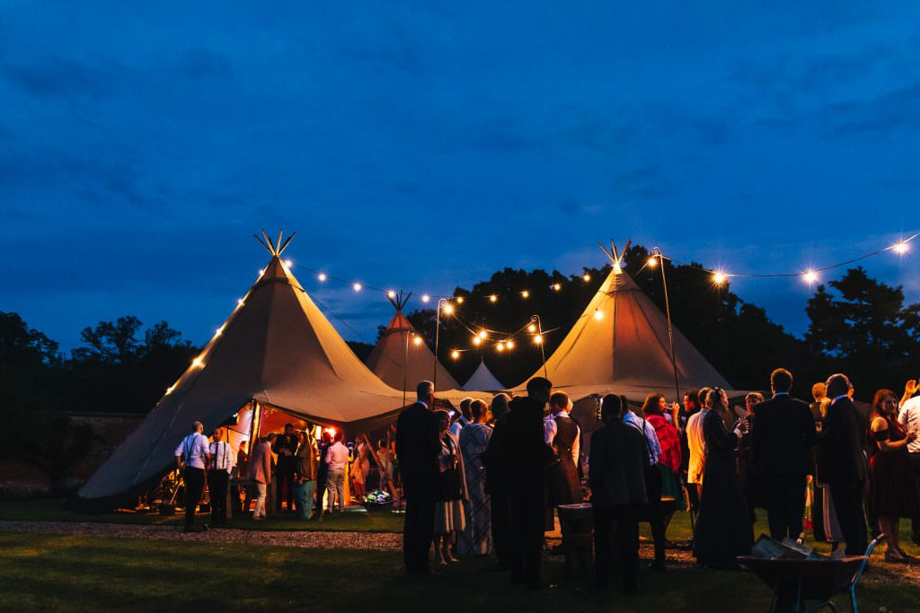 Tipi at night. festival style wedding at The Secret Walled Garden Wasing wedding.