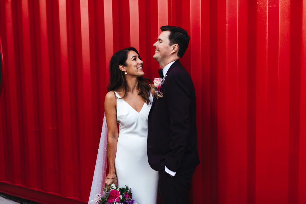 Natural and relaxed wedding photography at Sunset on top of a light house at Trinity Buoy Wharf Neon Wedding