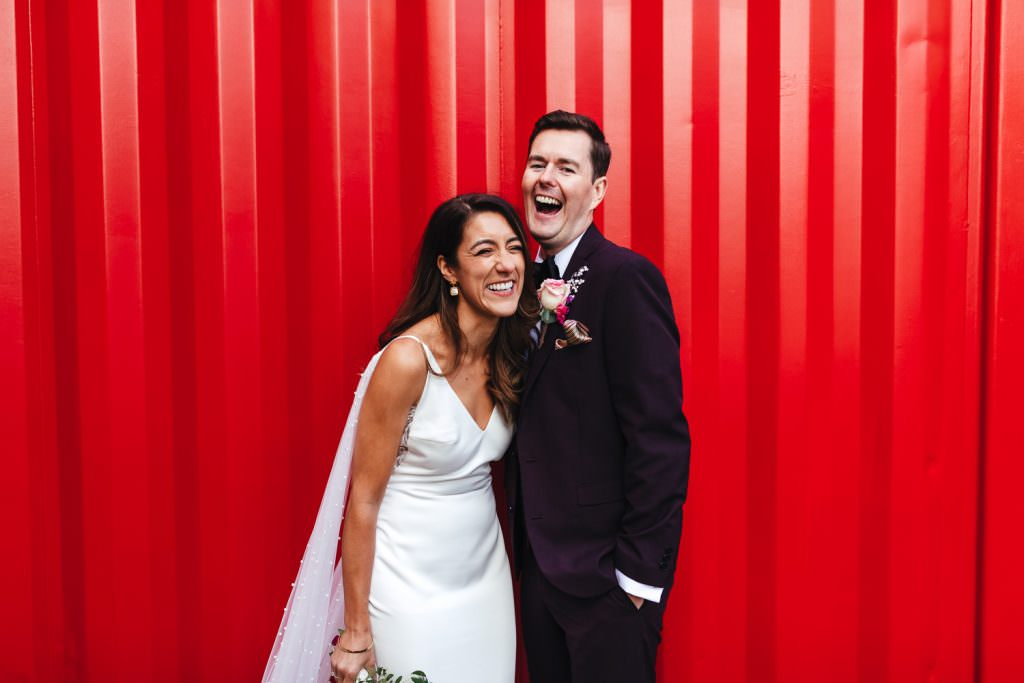 Natural and fun wedding photography at Trinity Buoy Wharf Neon Wedding