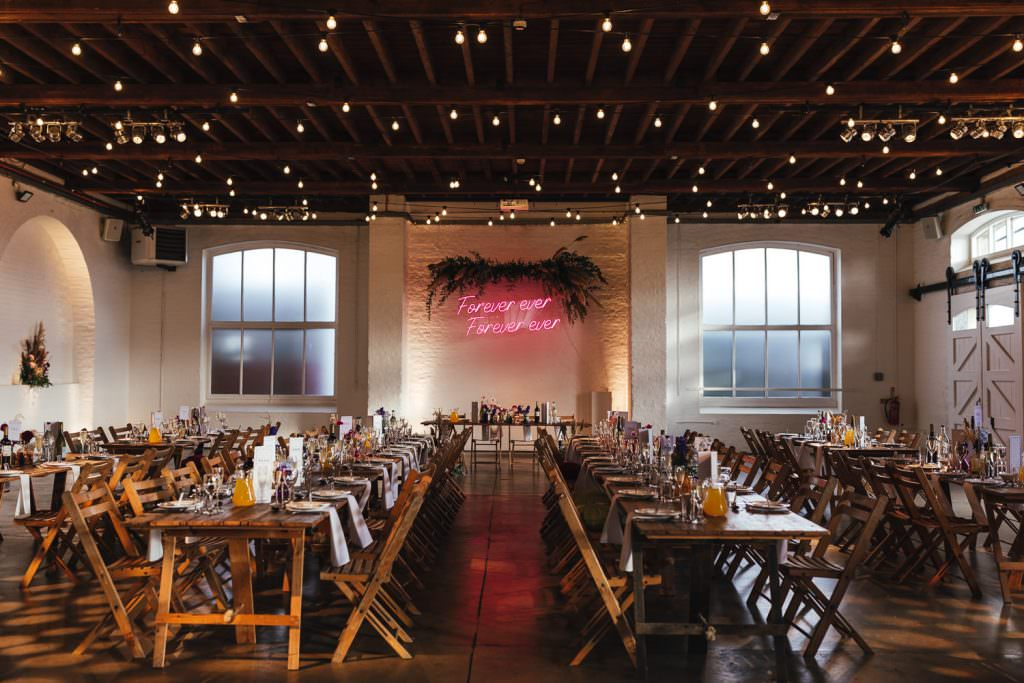 Urban colourful warehouse wedding decor and neon sign from neon poodle during Trinity Buoy Wharf Neon Wedding