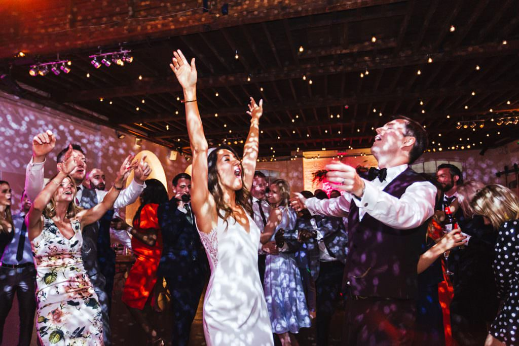 Party with bride and groom at Trinity Buoy Wharf Neon Wedding