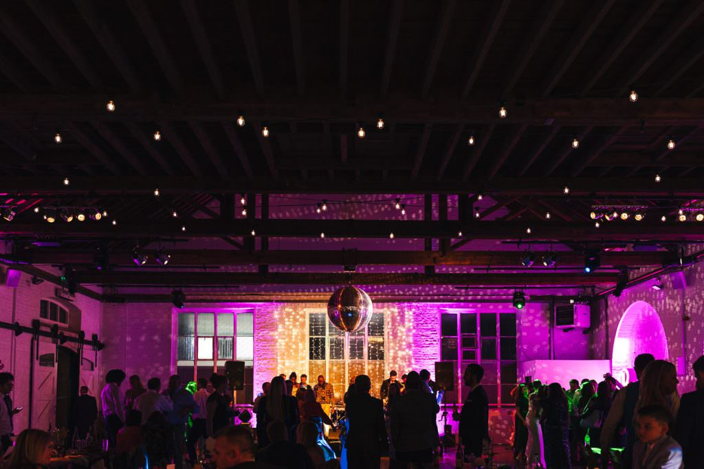 Party atmosphere at Trinity Buoy Wharf Neon Wedding