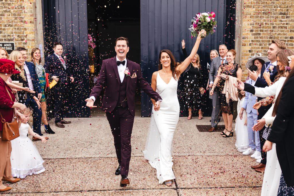 epic confetti exit at Trinity Buoy Wharf Neon Wedding