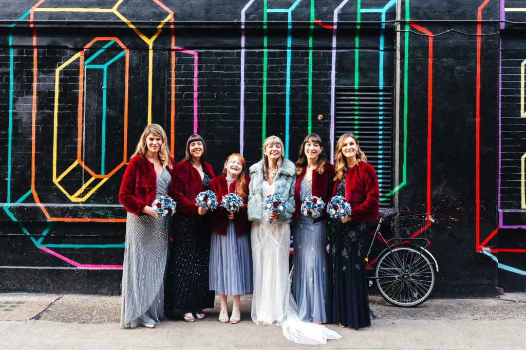 Winter Wedding Photography Tips - wear a warm coat! Bride and bridesmaids in fur jackets