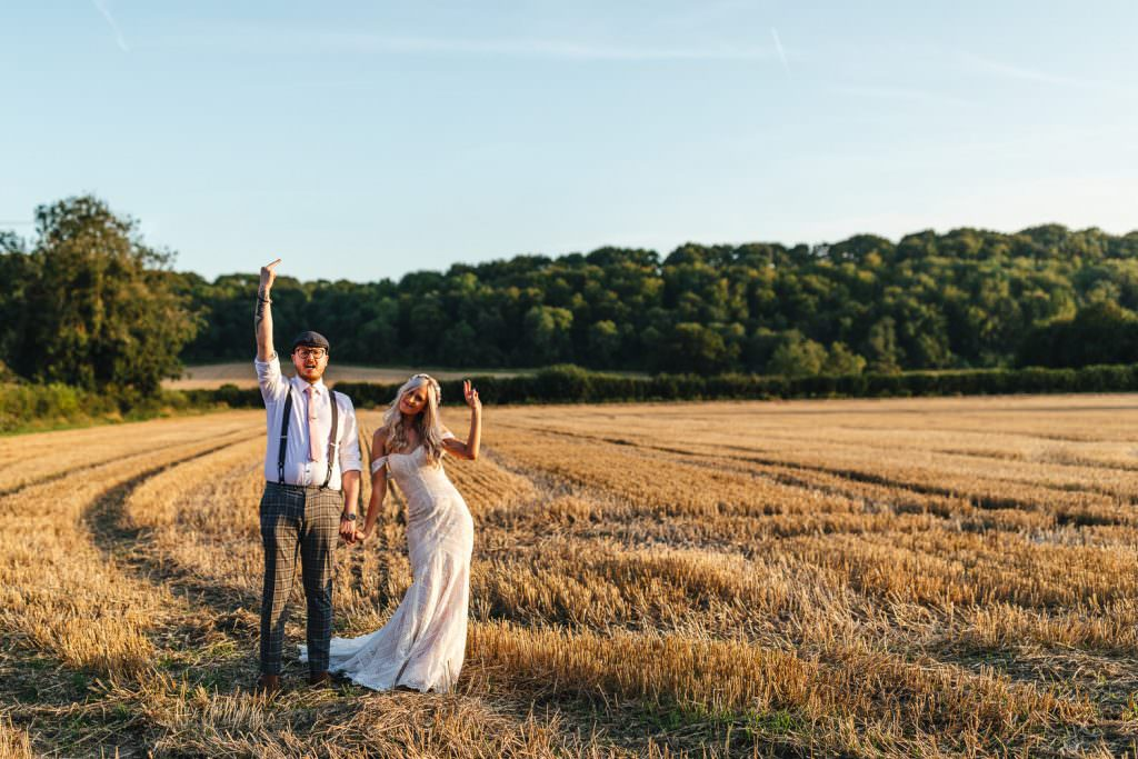 Fun wedding photography of bride and groom at Tithe Barn in Hampshire. Hampshire wedding photographer.
