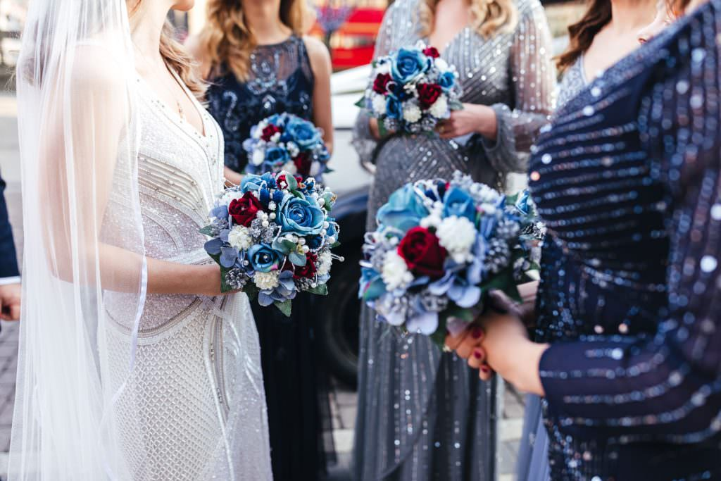 artificial wedding flowers.  London Wedding Photography | St Barts Brewery Wedding Photography | Winter Wedding Hackney Town Hall
