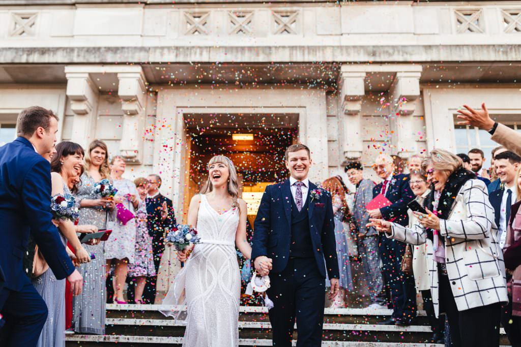 Colourful confetti London Wedding Photography | St Barts Brewery Wedding Photography | Winter Wedding Hackney Town Hall
