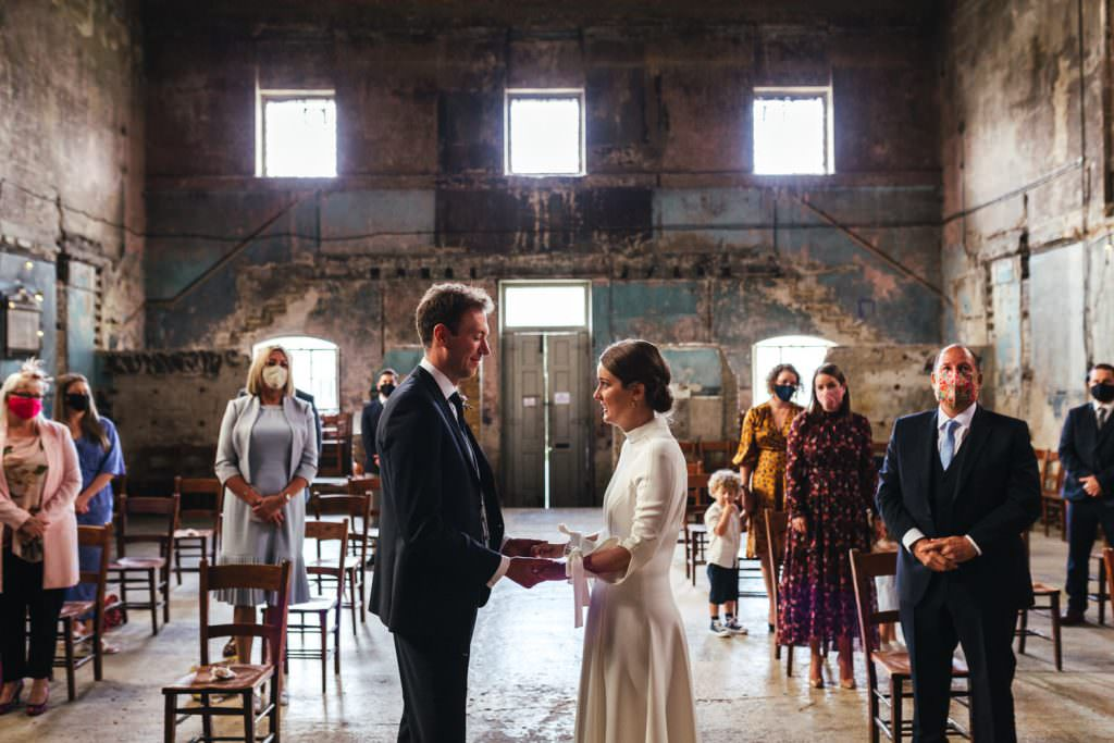 Covid Wedding ceremony with face masks Micro-Wedding Photography & Small Intimate Elopement Photographer during a pandemic