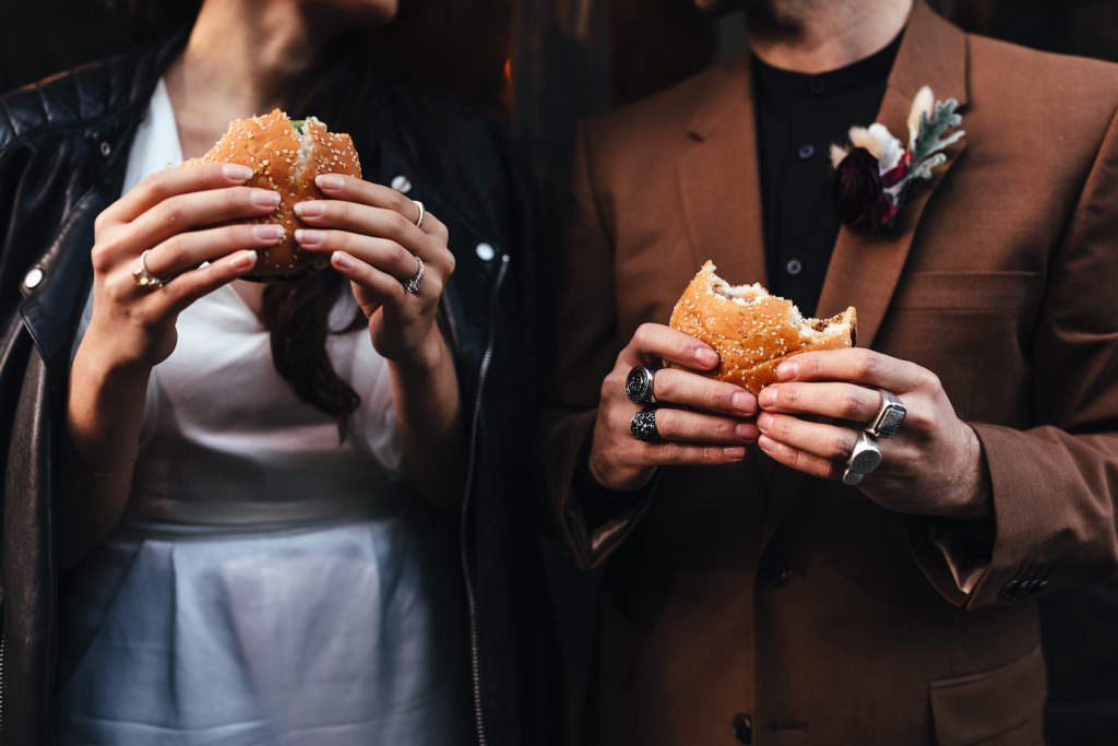 biker bride and groom have burgers at Clapton Country Club Wedding | Micro Wedding Photography